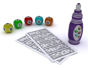 Bingo balls and card with dabber pen